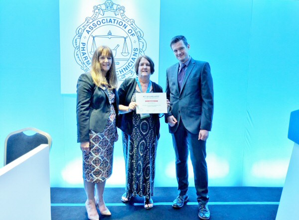 Karen Manson receiving 2nd place alongside Tess Fenn, APTUK and Chris Steng, Helapet Ltd